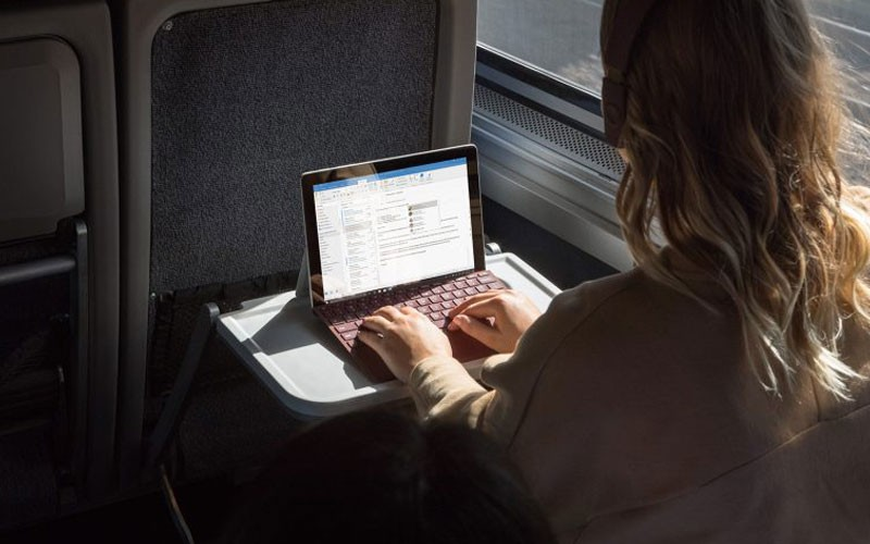 Business professional reading whitepaper off of tablet computer