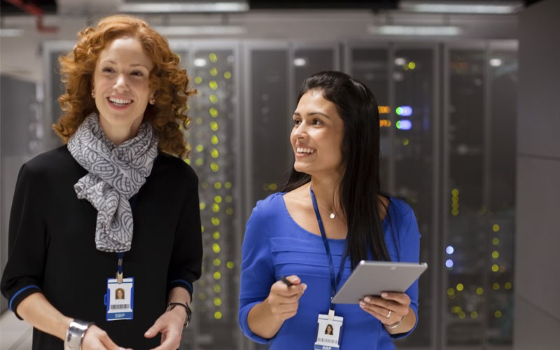 Two women smiling in data center