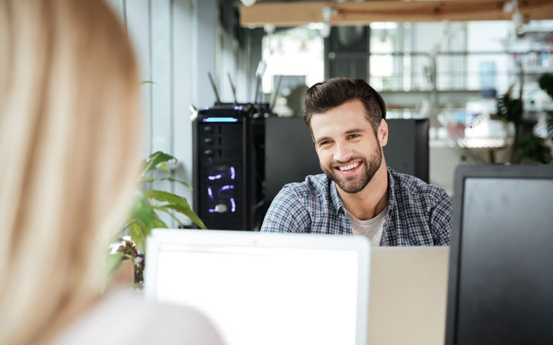 Employee smiling at desk