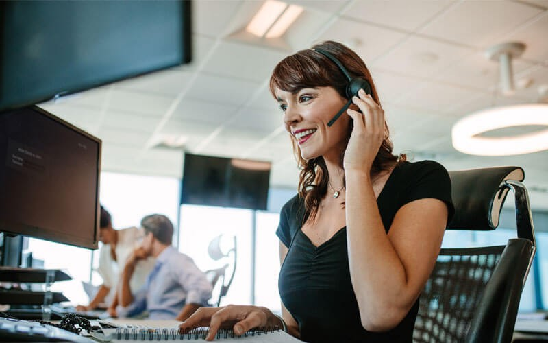 Call center representative in office with headset