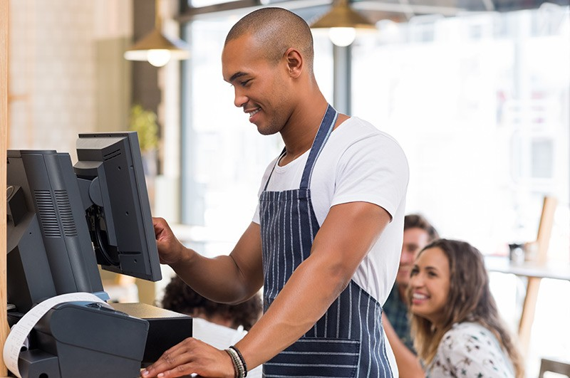 Small business owner using POS system