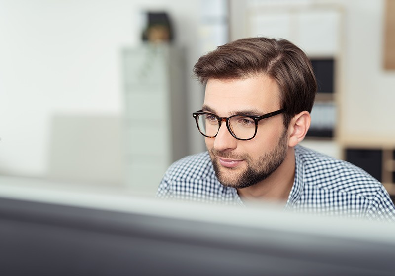 male employee using desktop and network connectivity